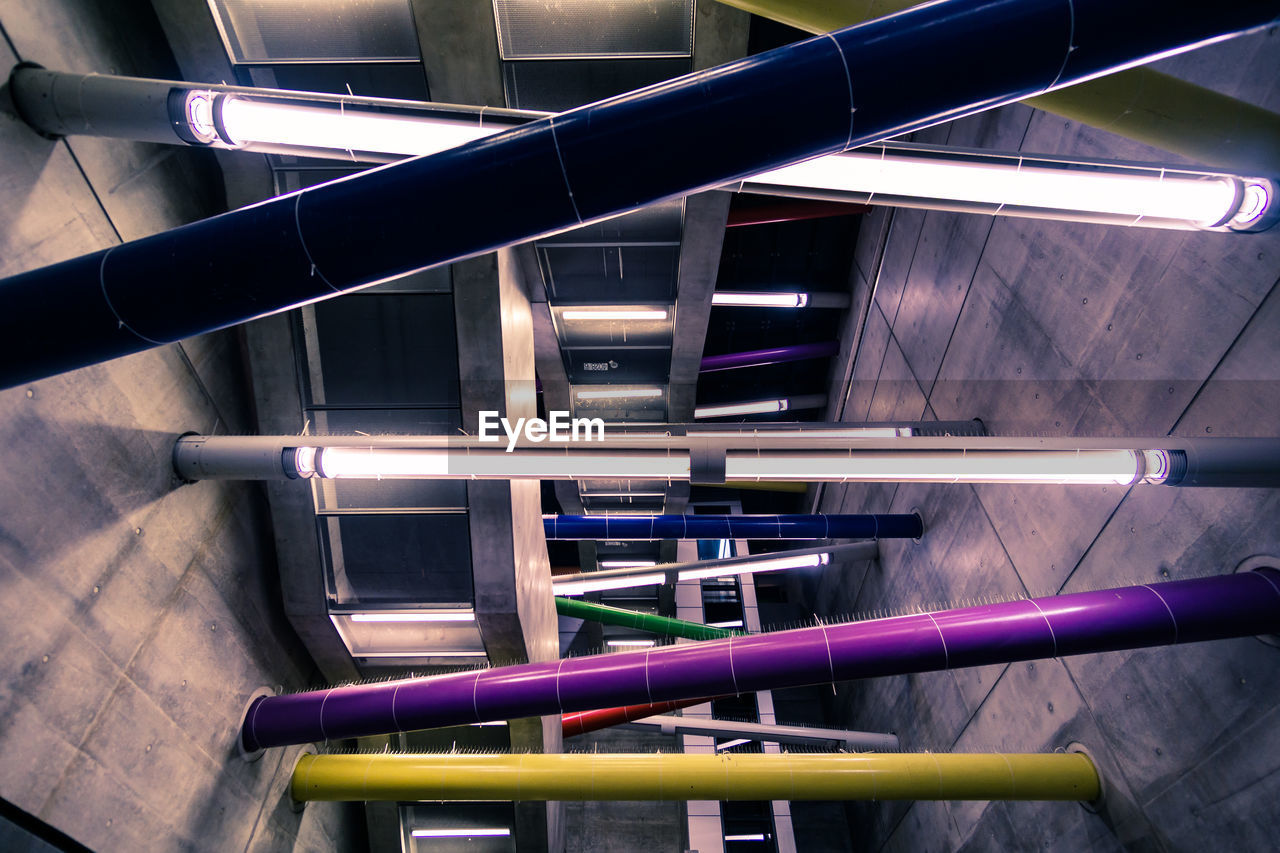 indoors, metal, no people, illuminated, high angle view, architecture, pattern, railing, built structure, close-up, staircase, lighting equipment, night, glowing, technology, blue, modern, multi colored, directly above, steel