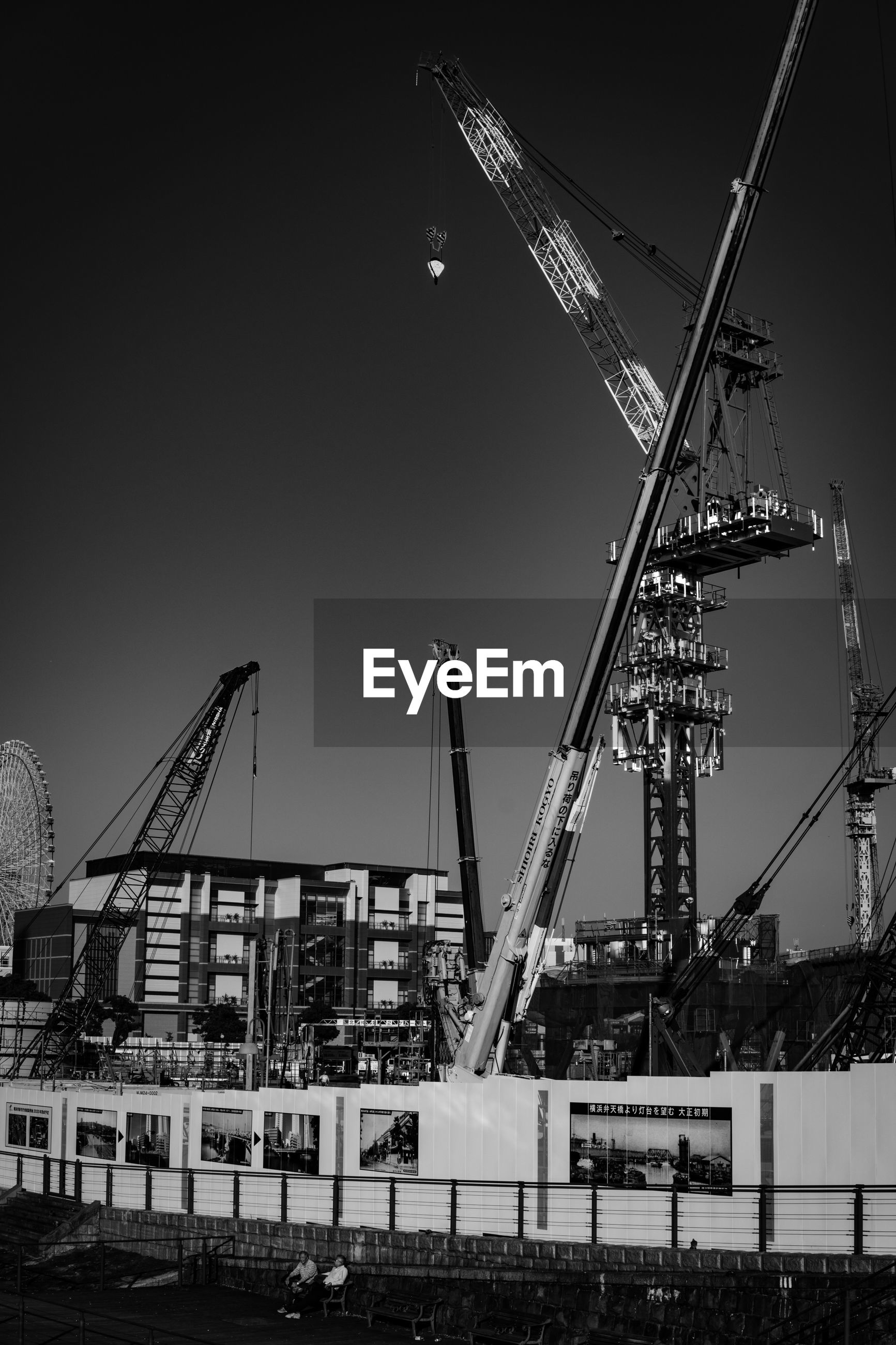architecture, built structure, building exterior, construction site, development, clear sky, crane - construction machinery, outdoors, industry, no people, city, sky, day, water, cityscape