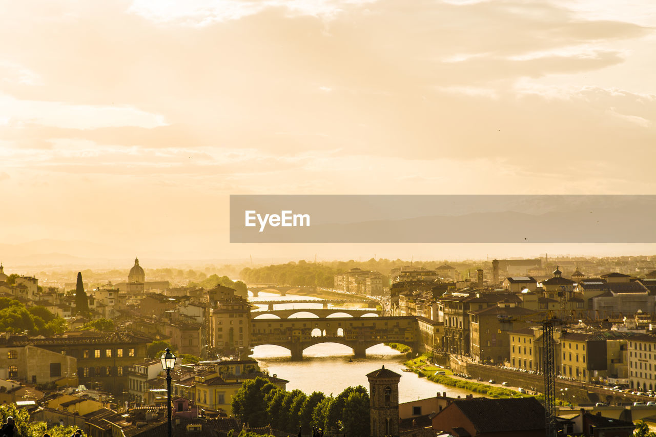 Arno River Amidst Cityscape Against Sky