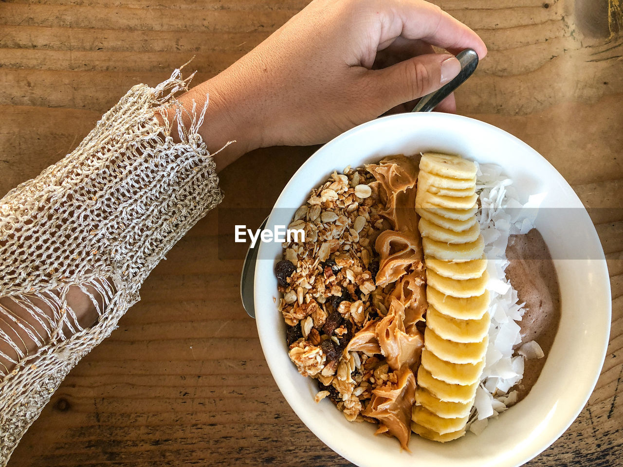 human hand, hand, food, food and drink, one person, human body part, freshness, real people, table, unrecognizable person, lifestyles, indoors, holding, high angle view, adult, women, sweet food, ready-to-eat, finger, temptation, breakfast