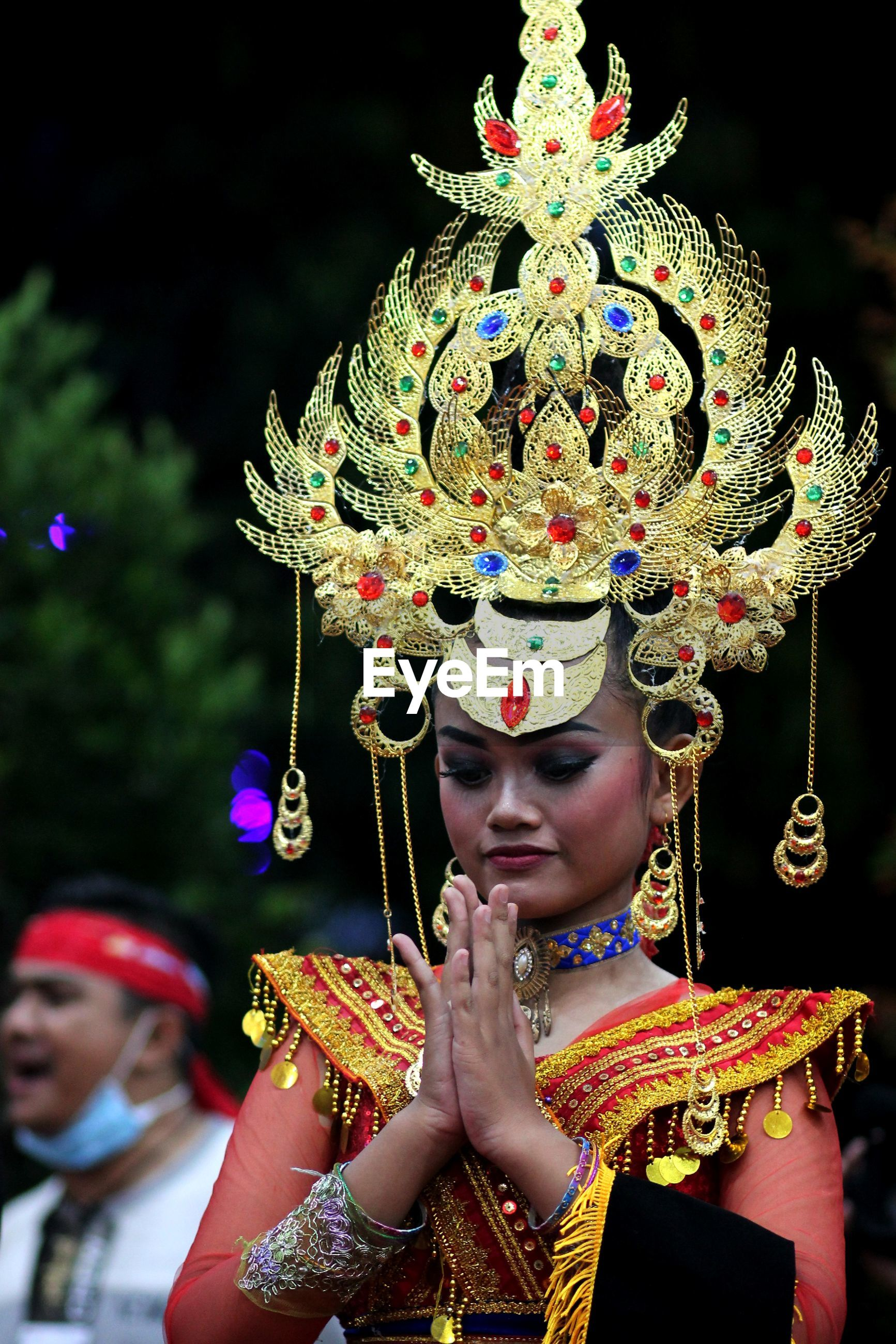 Young woman wearing headdress during festival