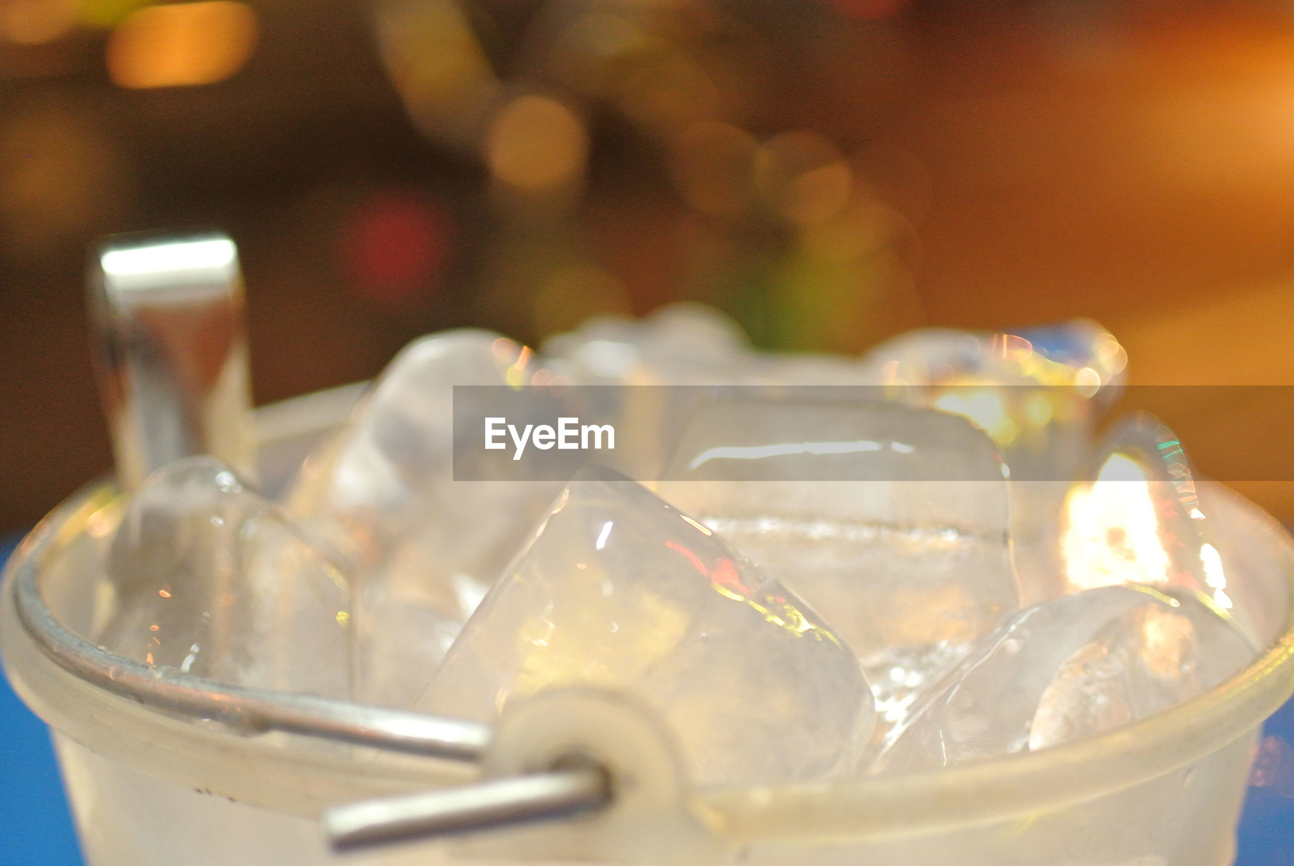 Close up of ice bucket on table