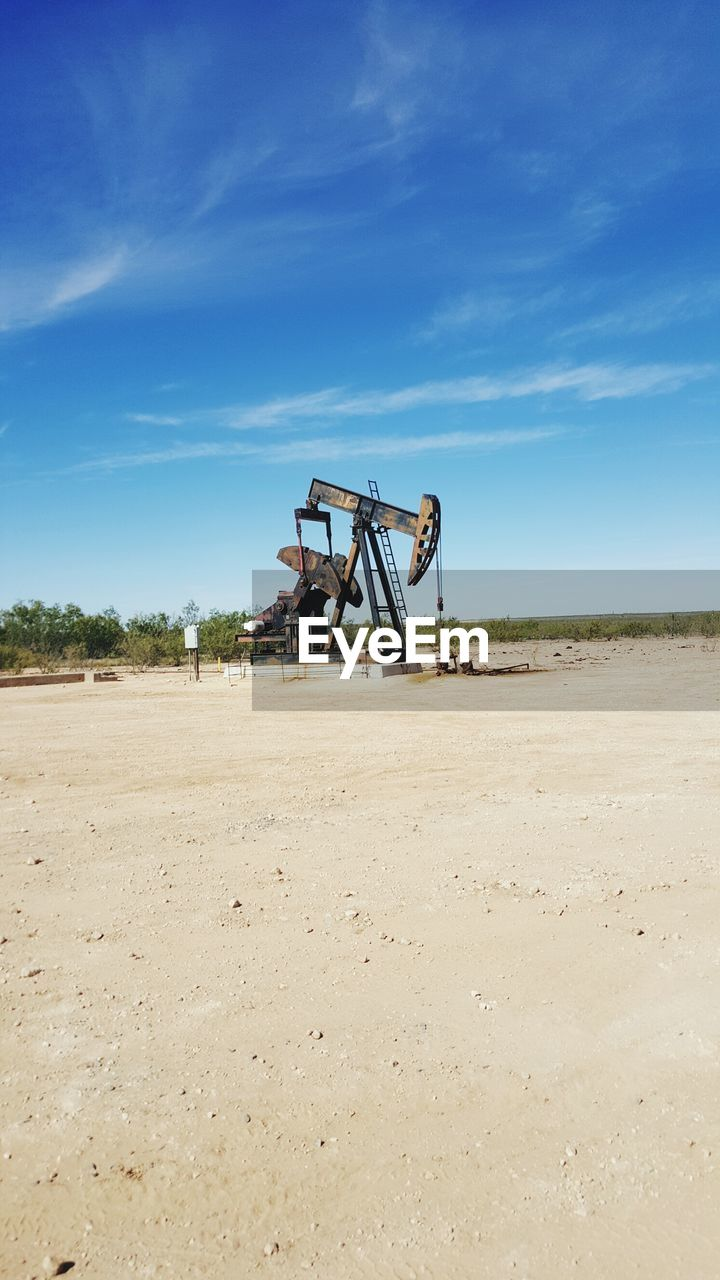 Oil Drill On Field Against Sky