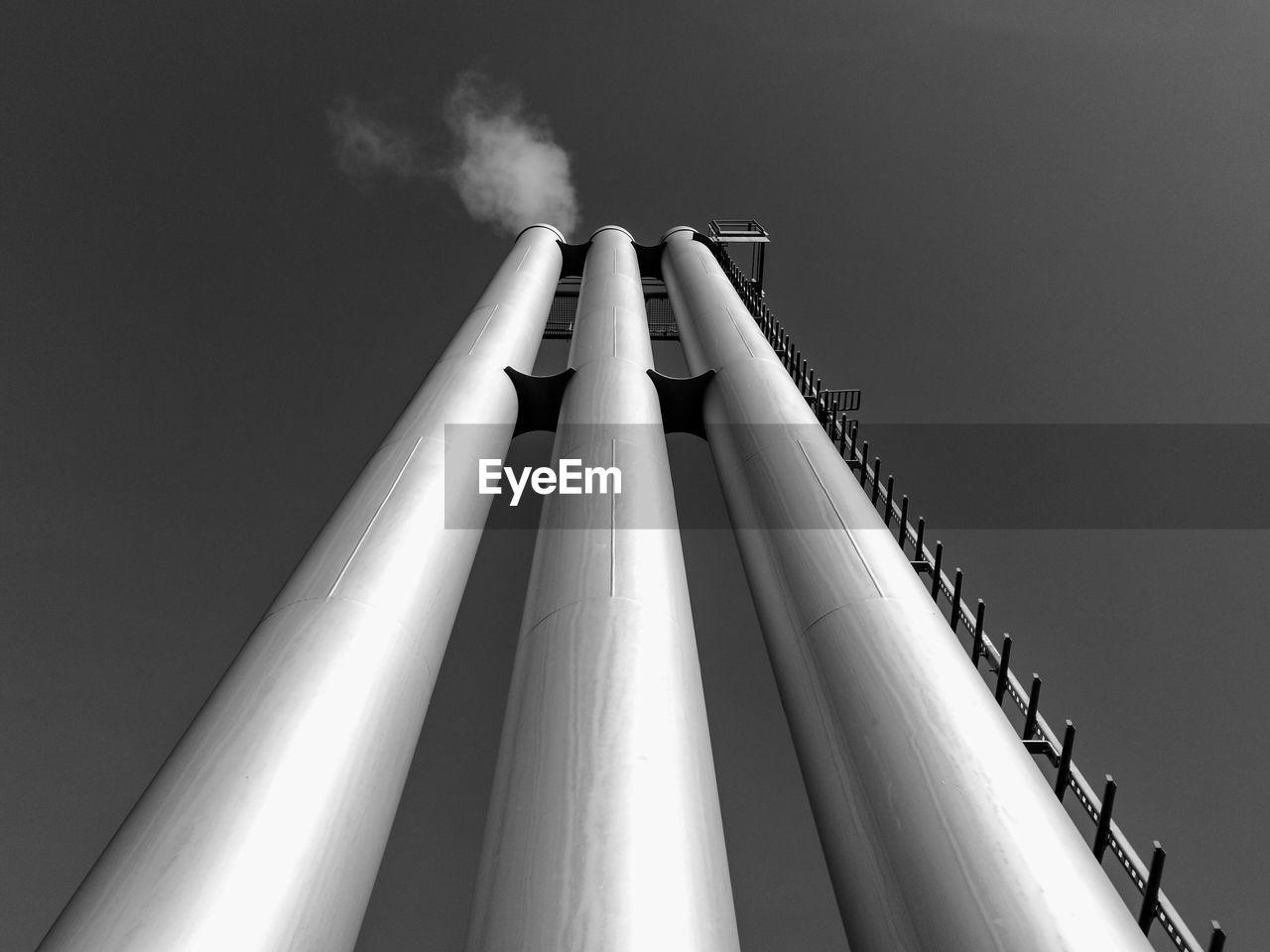 Low Angle View Of Smoke Stacks