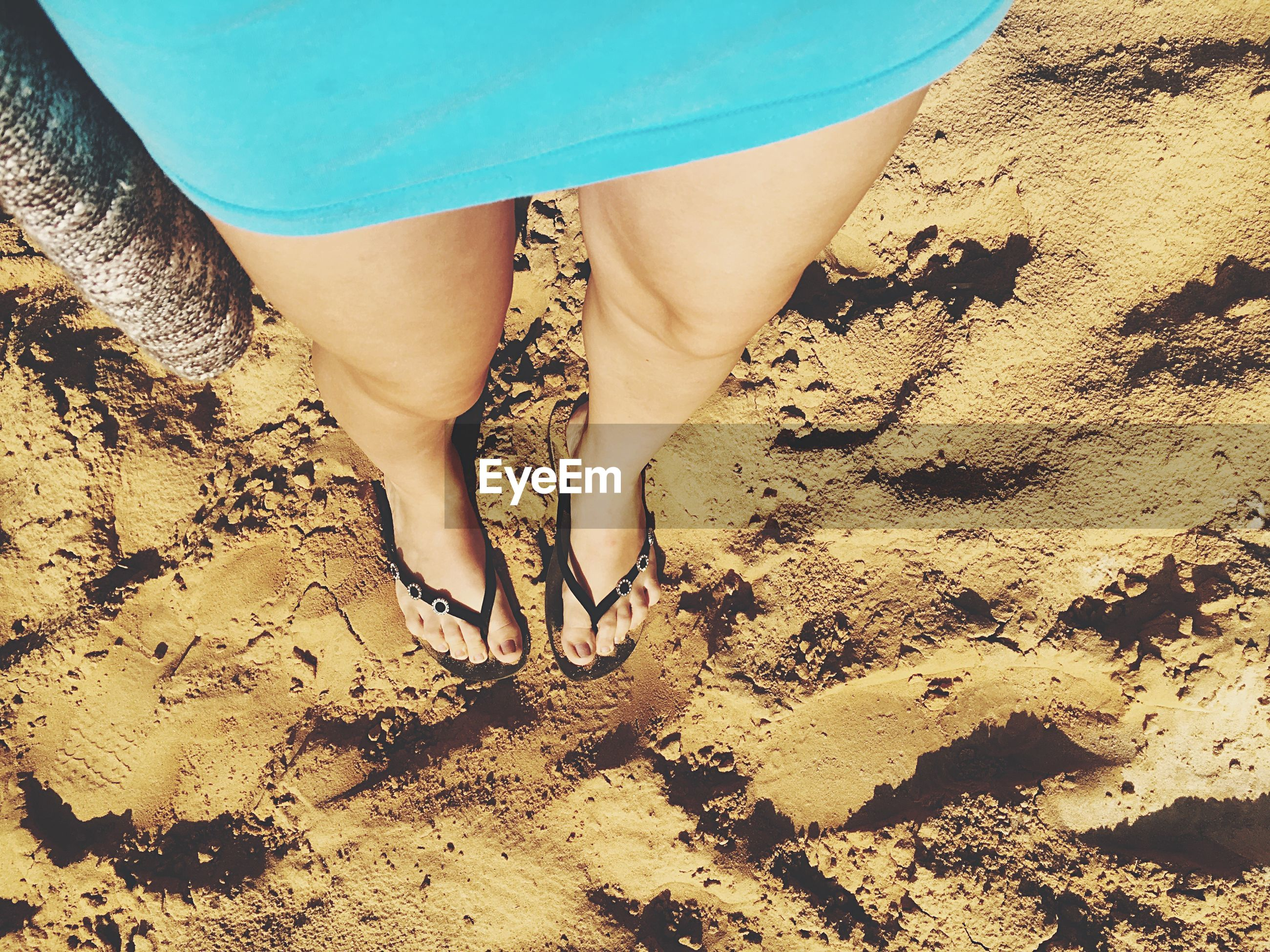 sand, beach, low section, lifestyles, leisure activity, barefoot, shore, sunlight, outdoors, day, vacations, nature, part of, close-up, sunny, beauty in nature, tranquility