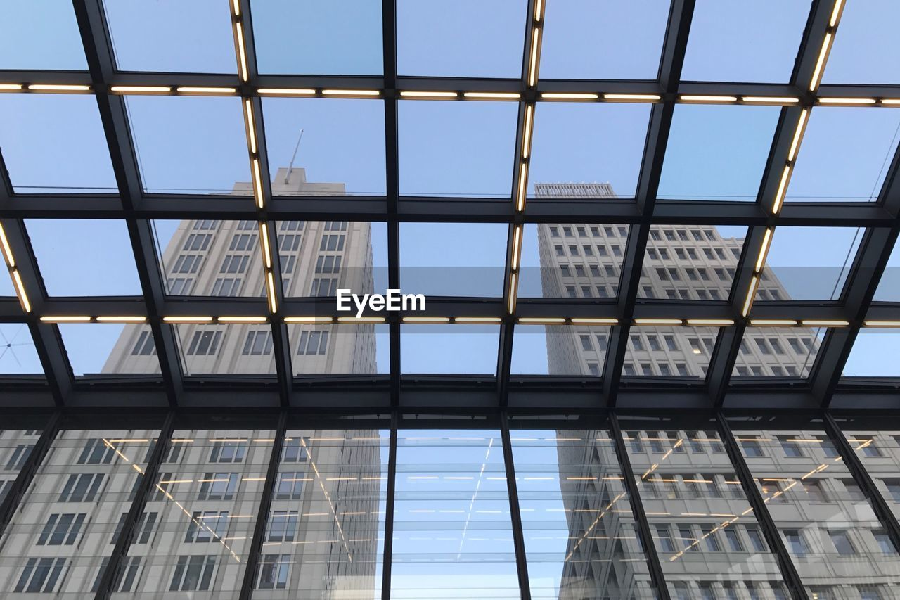 architecture, built structure, window, modern, indoors, skyscraper, day, building exterior, no people, low angle view, sky, city, clear sky