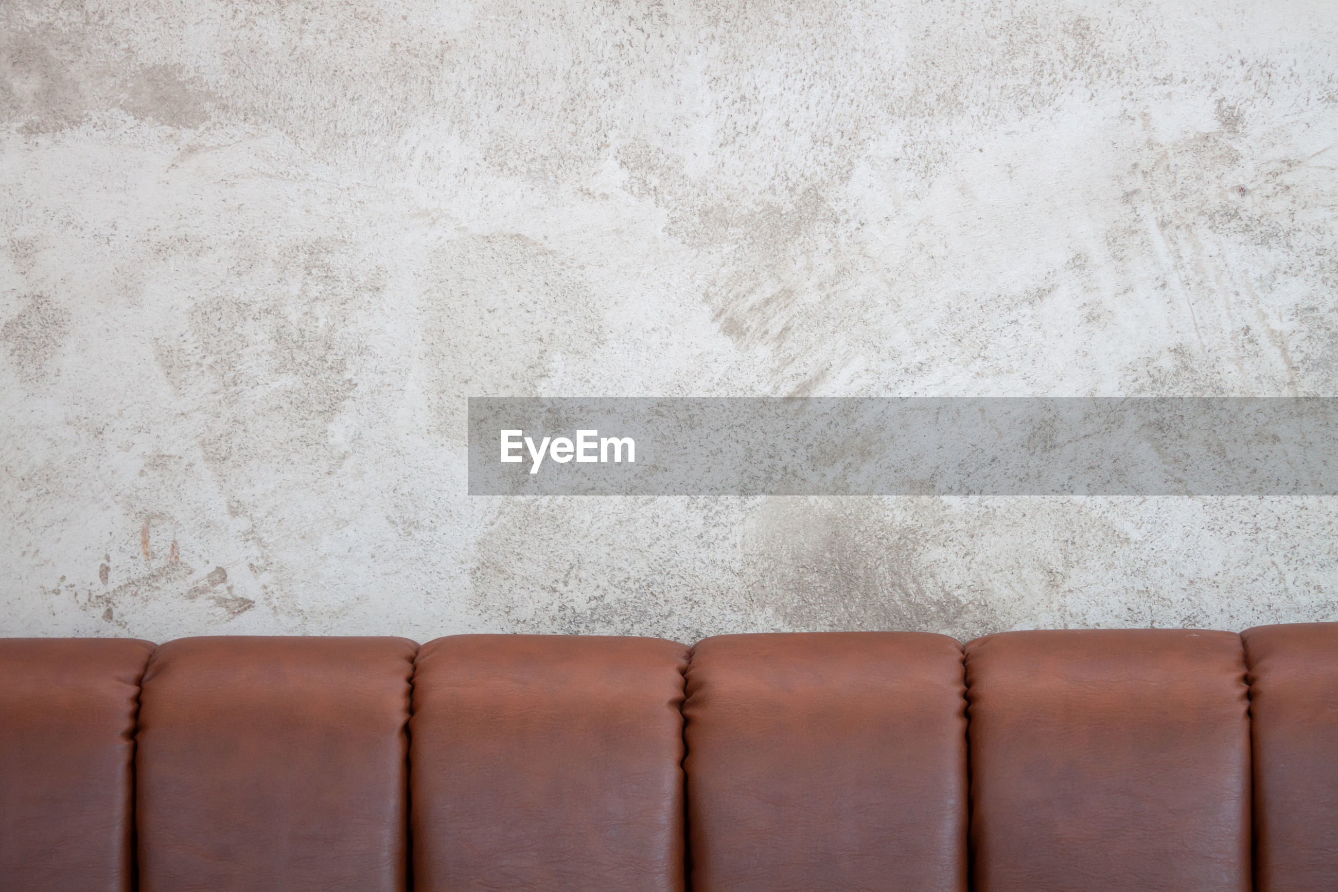 CLOSE-UP OF WHITE WALL WITH CONCRETE