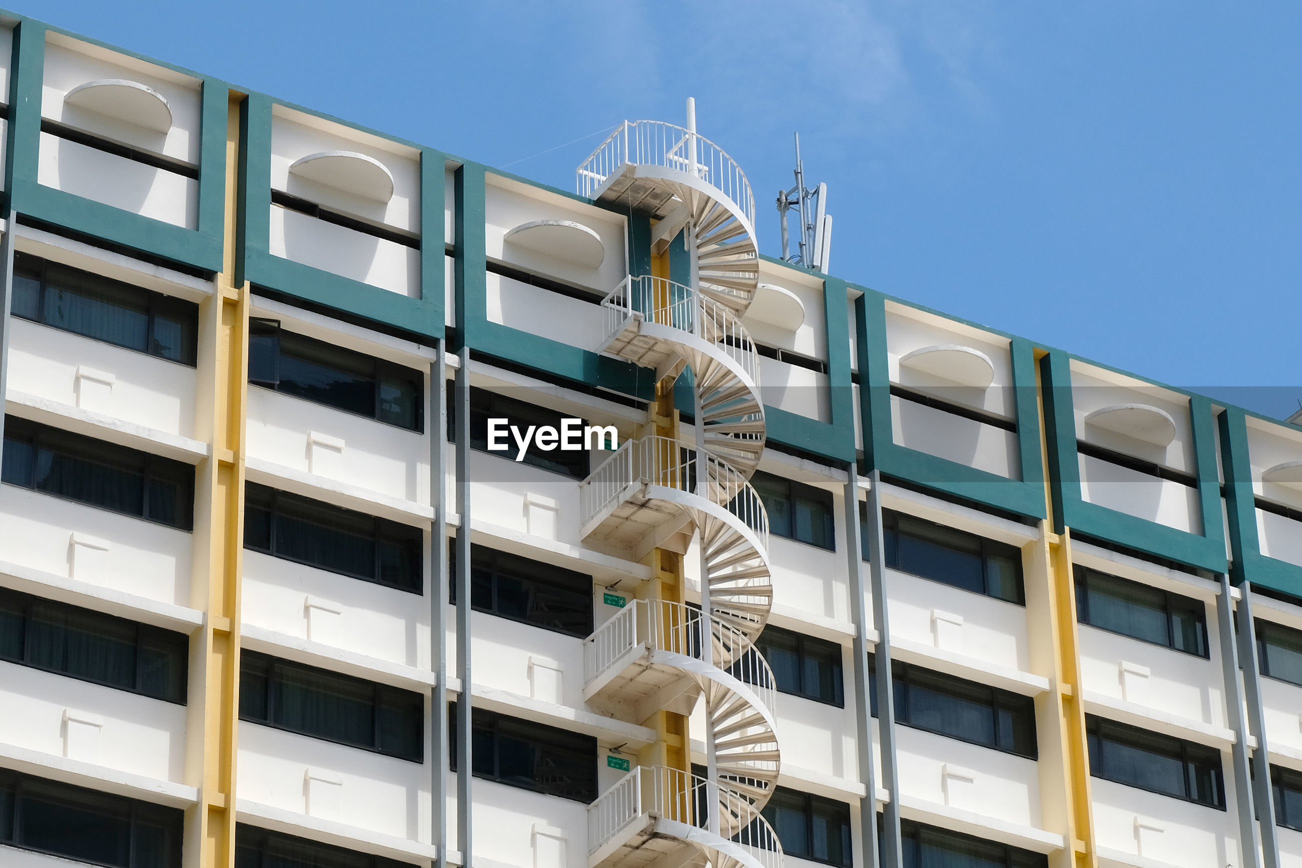Low angle view of fire escape on building against sky
