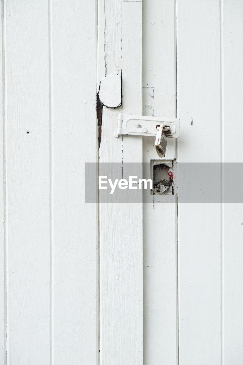 entrance, door, protection, security, safety, white color, no people, built structure, architecture, metal, lock, closed, close-up, day, building exterior, wall - building feature, outdoors, latch, wood - material, full frame