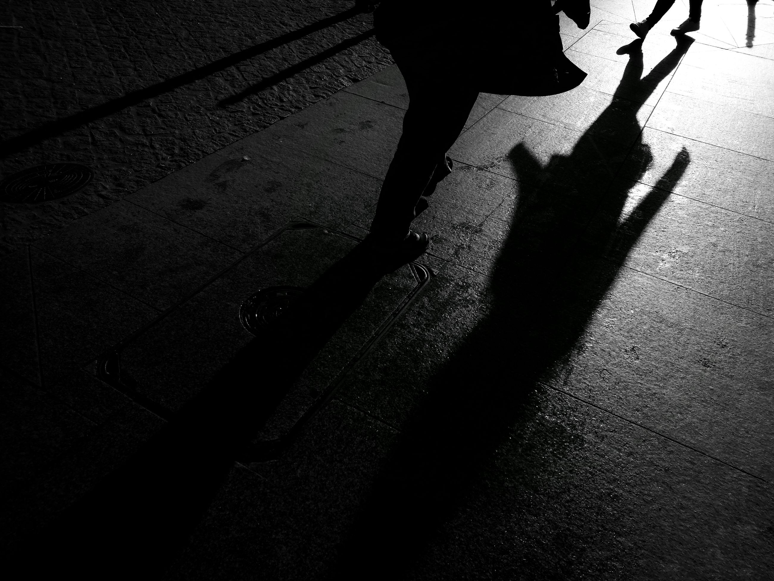 shadow, low section, street, walking, person, footpath, black and white, outdoors, dark, city life, focus on shadow