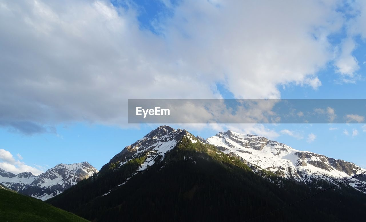 mountain, sky, cloud - sky, snow, cold temperature, beauty in nature, scenics - nature, tranquil scene, winter, tranquility, mountain range, snowcapped mountain, nature, environment, non-urban scene, mountain peak, day, no people, idyllic, outdoors