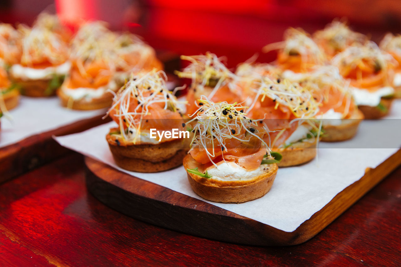 freshness, food, food and drink, healthy eating, ready-to-eat, still life, table, wellbeing, seafood, plate, focus on foreground, indoors, close-up, serving size, no people, fruit, appetizer, selective focus, salmon - seafood, indulgence, japanese food, snack, tray, garnish, temptation