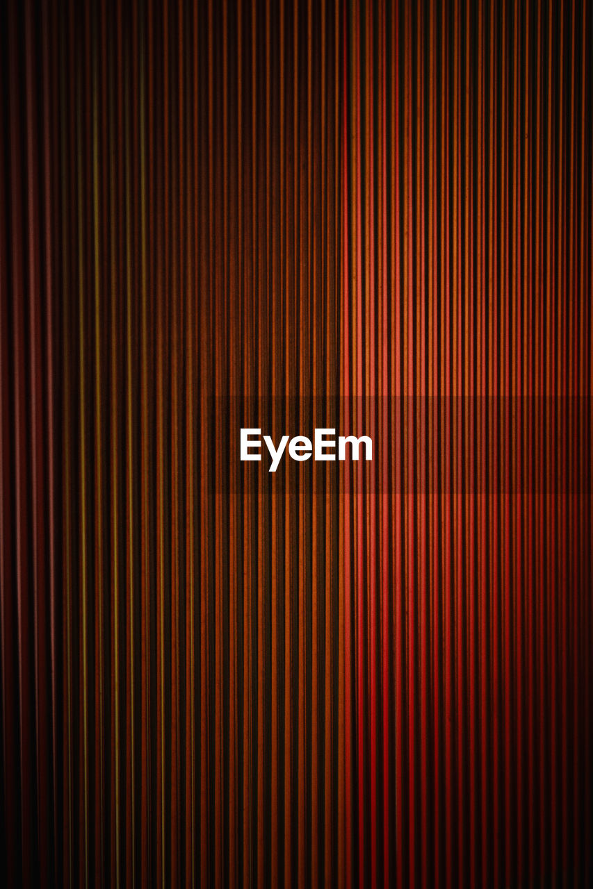 backgrounds, pattern, red, no people, full frame, textured, close-up, abstract, indoors, striped, textile, curtain, arts culture and entertainment, brown, in a row, dark, repetition, textured effect, elegance, stage theater, nightlife, clean