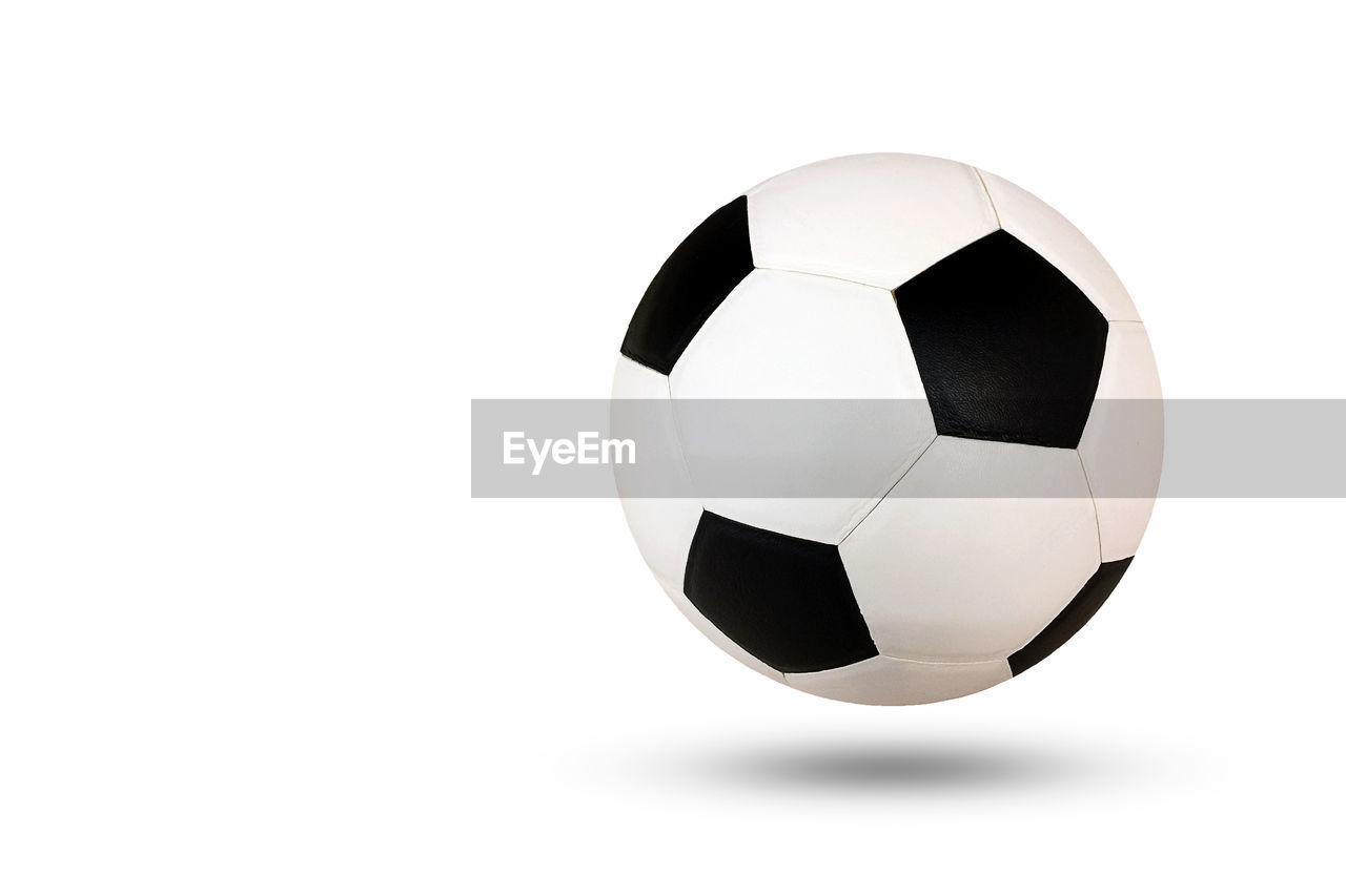 Close-Up Of Soccer Balls Levitating Against White Background