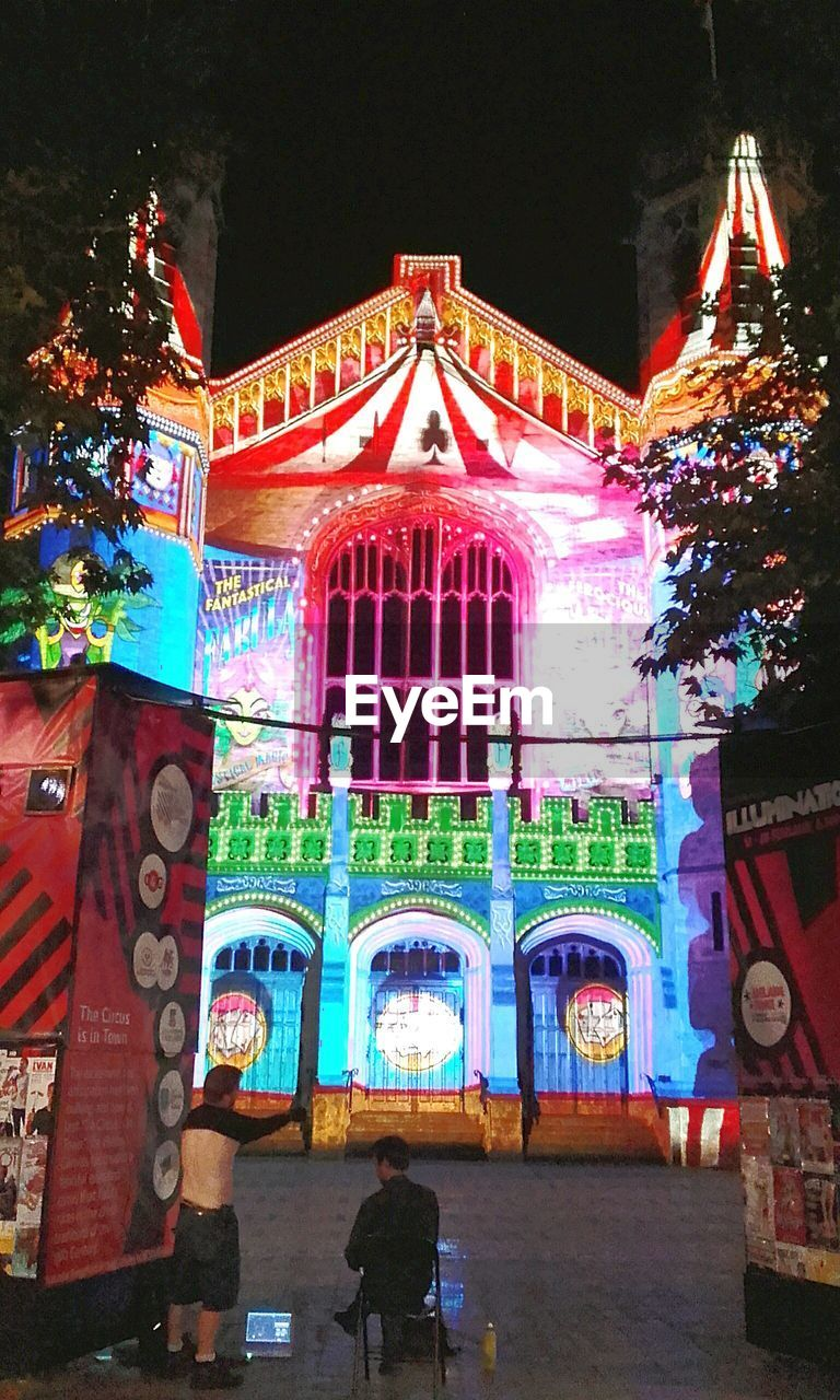 built structure, architecture, night, multi colored, real people, building exterior, illuminated, place of worship, low angle view, outdoors