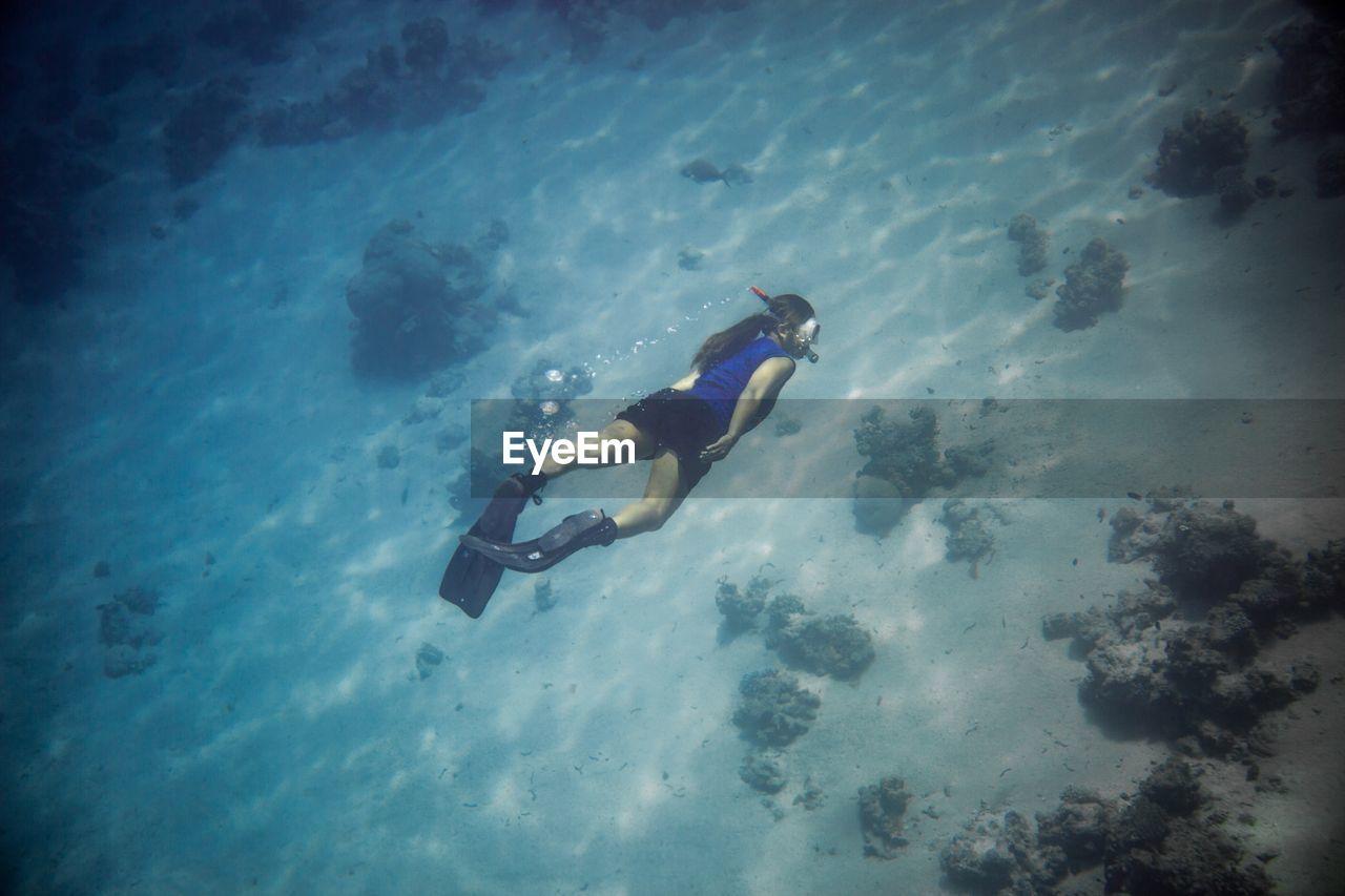 Woman diving undersea