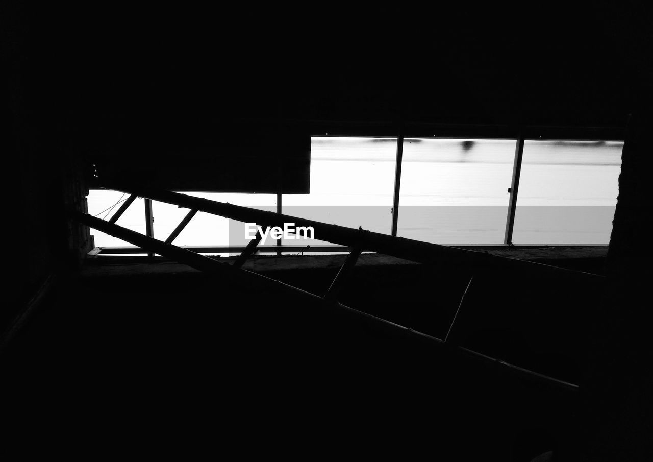 indoors, silhouette, built structure, architecture, window, low angle view, day, no people, sky