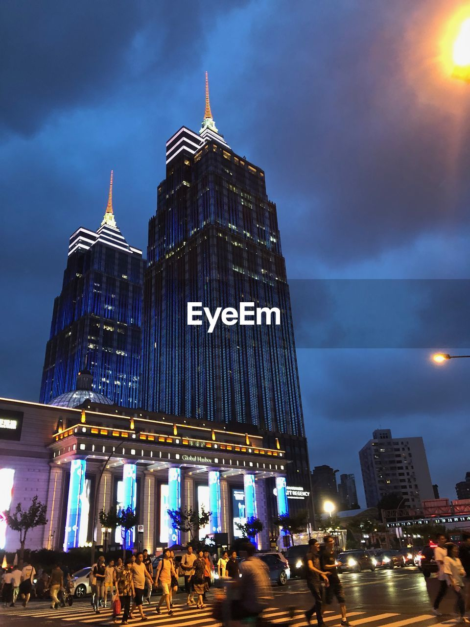 architecture, built structure, building exterior, illuminated, sky, city, cloud - sky, travel destinations, building, night, nature, travel, office building exterior, low angle view, skyscraper, tower, tourism, tall - high, incidental people, outdoors, modern, government