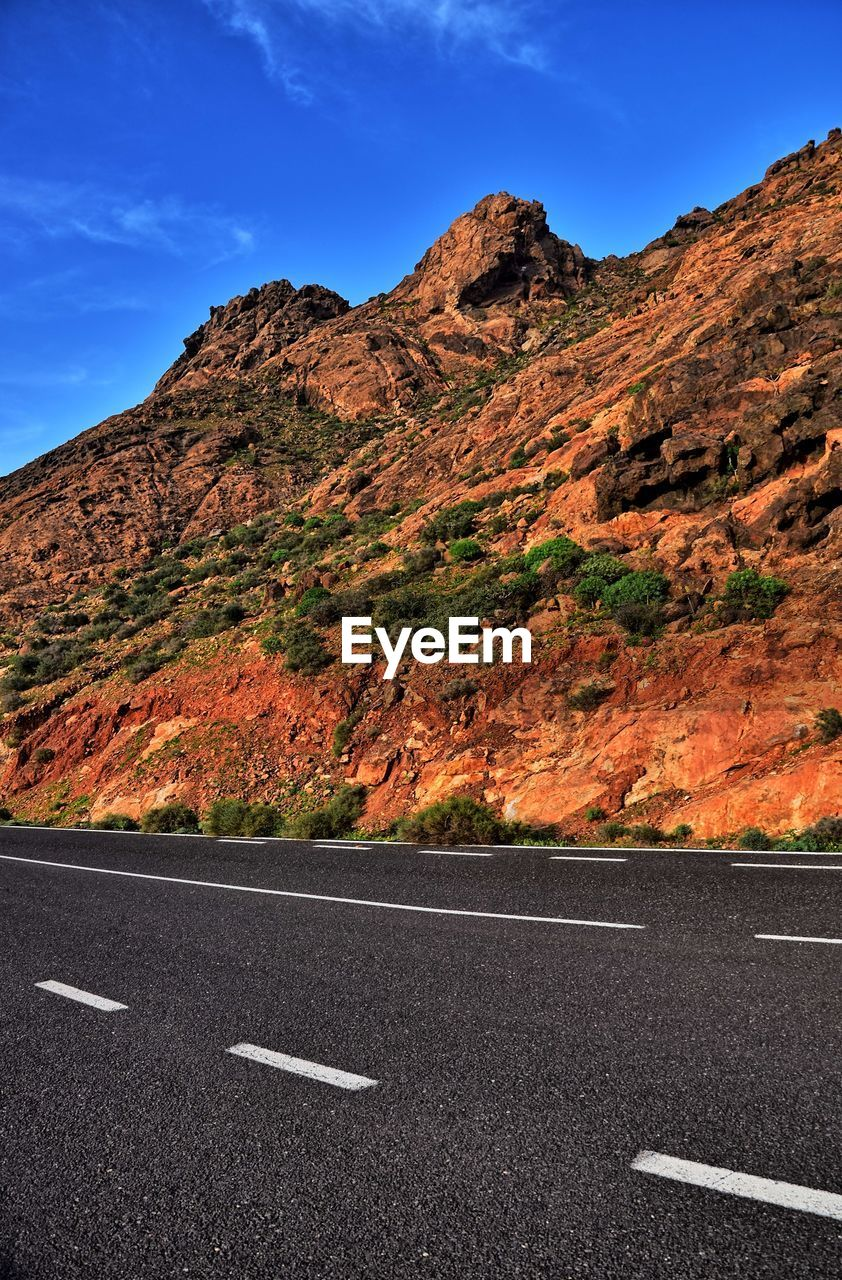 ROAD BY MOUNTAIN