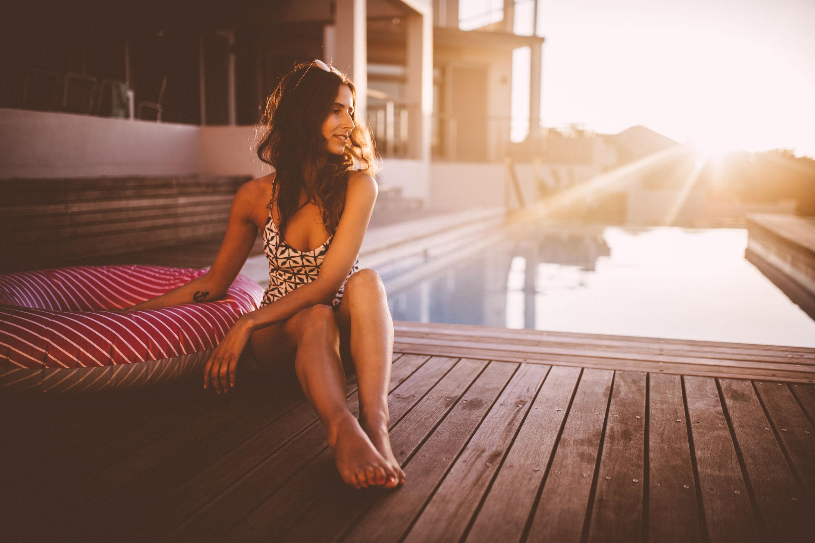 Portrait of woman near swimming pool