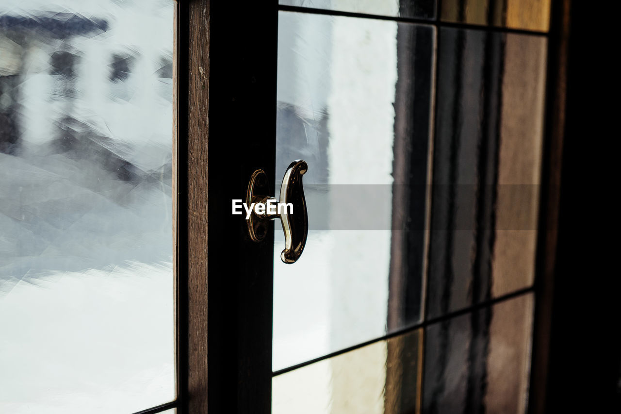 window, door, entrance, no people, glass - material, safety, transparent, indoors, knob, handle, focus on foreground, close-up, day, metal, security, protection, closed, architecture, doorknob