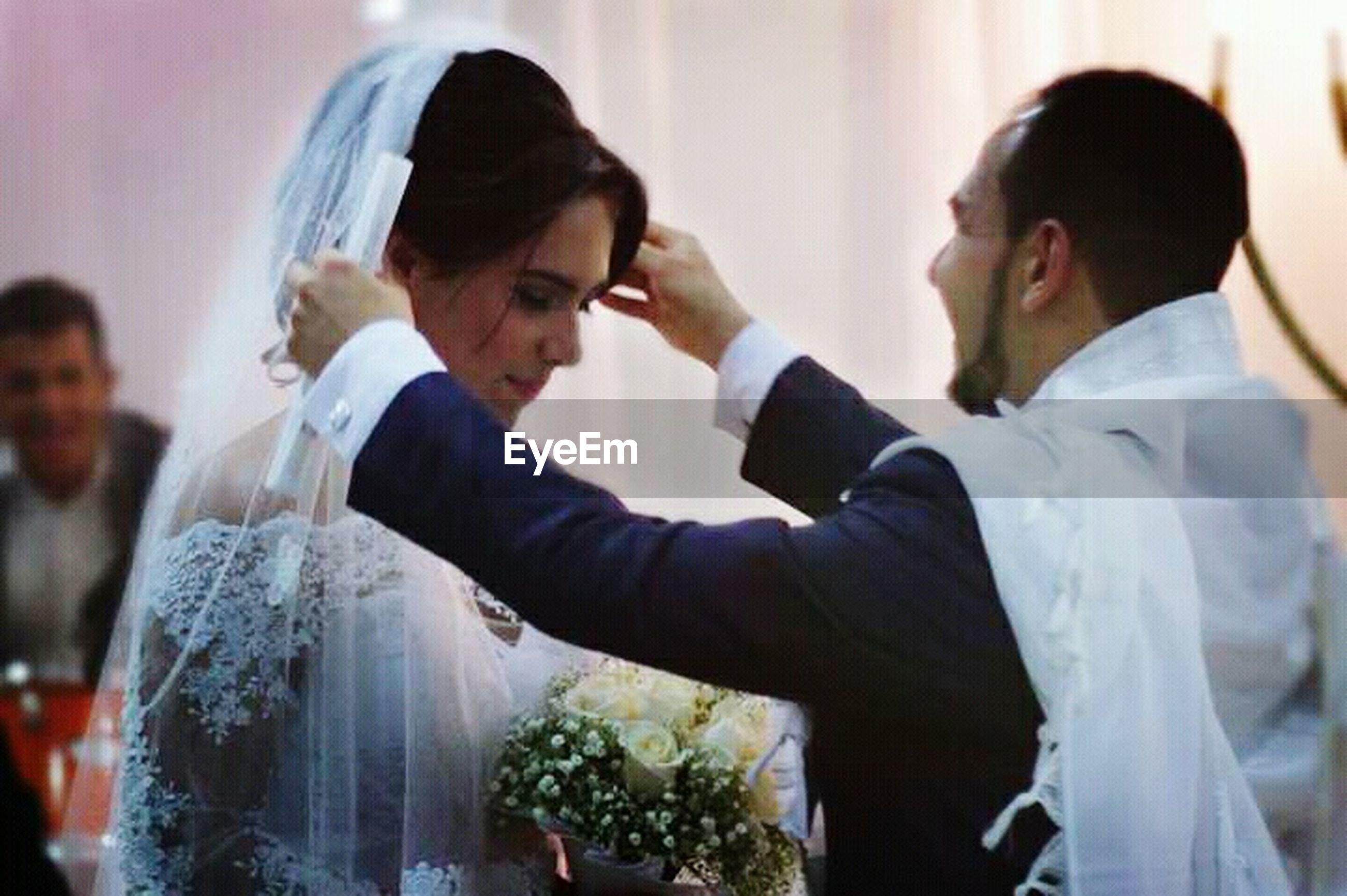 wedding, bride, bridegroom, celebration, wedding ceremony, wedding dress, life events, indoors, women, ceremony, well-dressed, veil, men, two people, wife, husband, adults only, celebration event, adult, standing, suit, married, people, young adult, day, togetherness, young women, dedication, groom, close-up