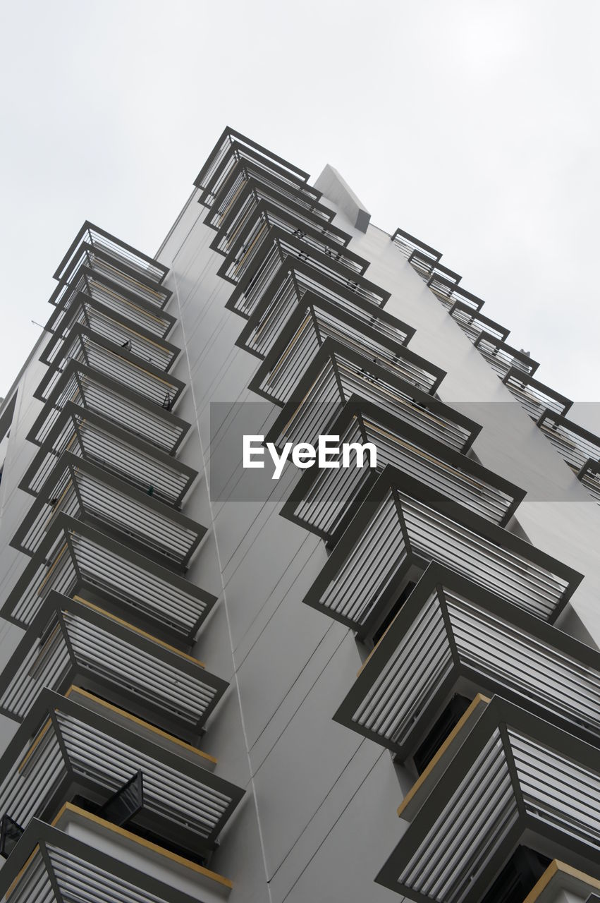 architecture, low angle view, built structure, building exterior, staircase, steps and staircases, steps, outdoors, modern, day, no people, zigzag, sky