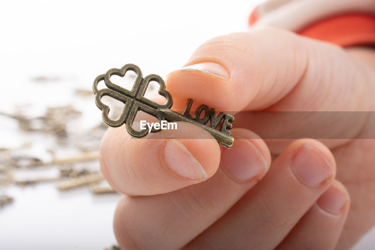 human hand, hand, human body part, body part, finger, human finger, real people, one person, unrecognizable person, close-up, focus on foreground, holding, personal perspective, jewelry, lifestyles, leisure activity, day, outdoors, personal accessory, human foot