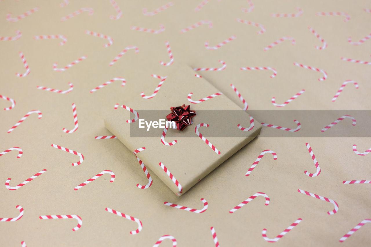High angle view of christmas present on table