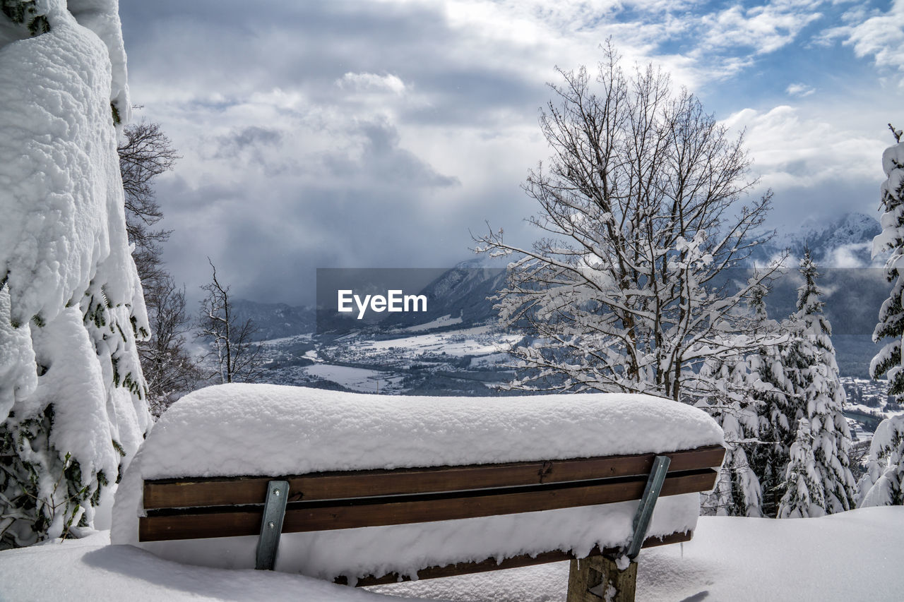 snow, winter, cold temperature, cloud - sky, sky, tree, mountain, scenics - nature, beauty in nature, white color, nature, day, covering, tranquil scene, tranquility, snowcapped mountain, no people, bench, wood - material, extreme weather