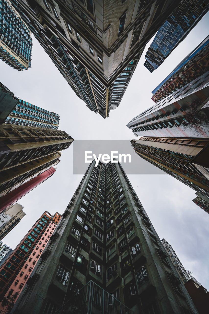 building exterior, architecture, built structure, low angle view, city, building, sky, tall - high, no people, office building exterior, travel destinations, nature, office, day, skyscraper, tower, directly below, modern, outdoors, travel, financial district, apartment