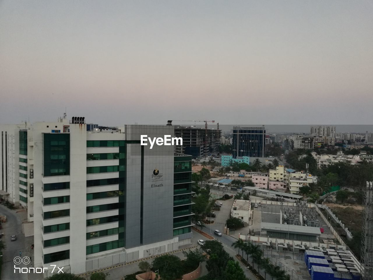 built structure, architecture, building exterior, city, building, sky, residential district, no people, nature, high angle view, cityscape, outdoors, clear sky, copy space, modern, tree, plant, sunset, day, apartment, office building exterior, skyscraper
