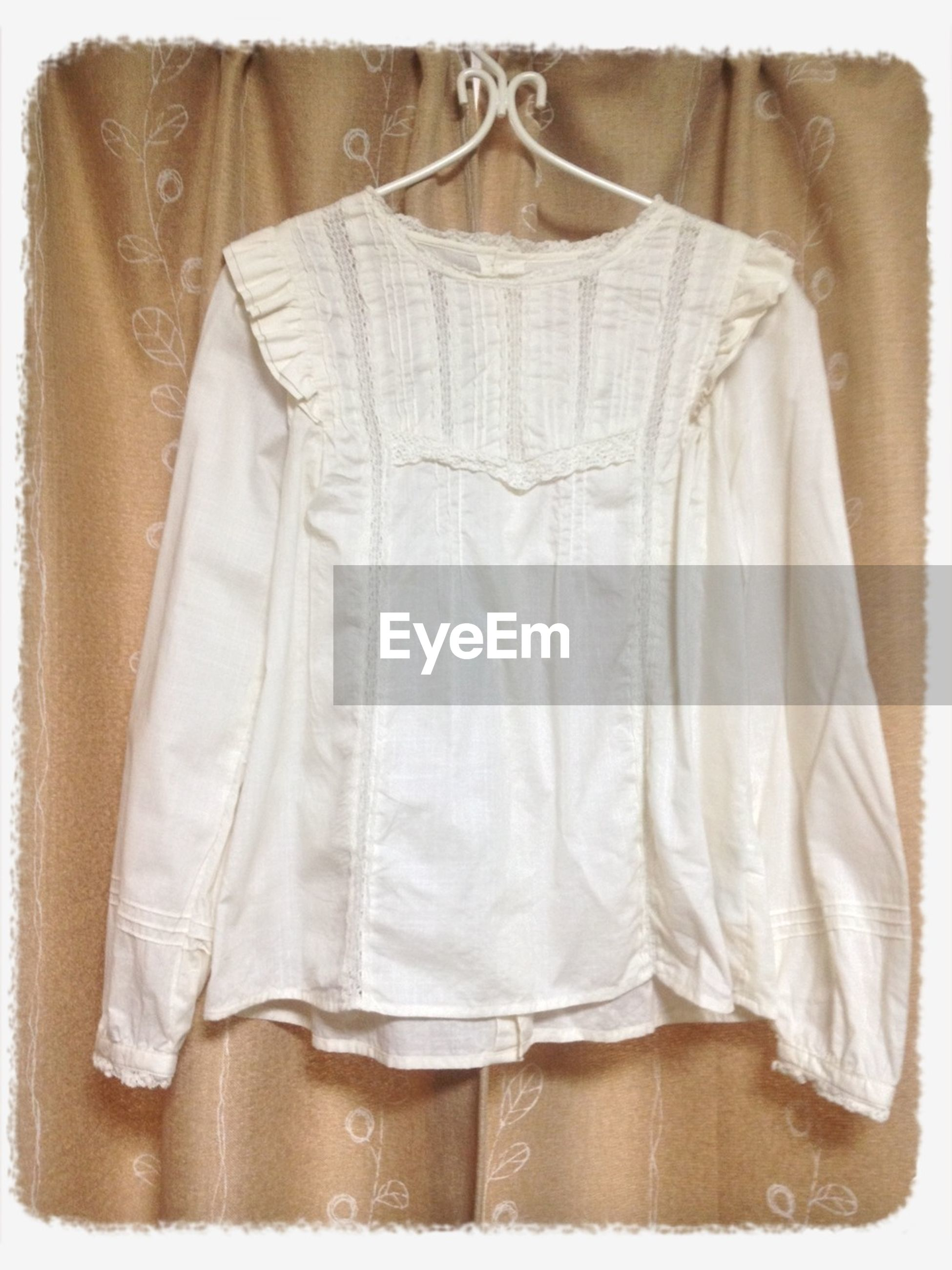 indoors, textile, clothing, fabric, midsection, fashion, curtain, hanging, white color, transfer print, person, standing, casual clothing, men, religion, shirt, auto post production filter, close-up