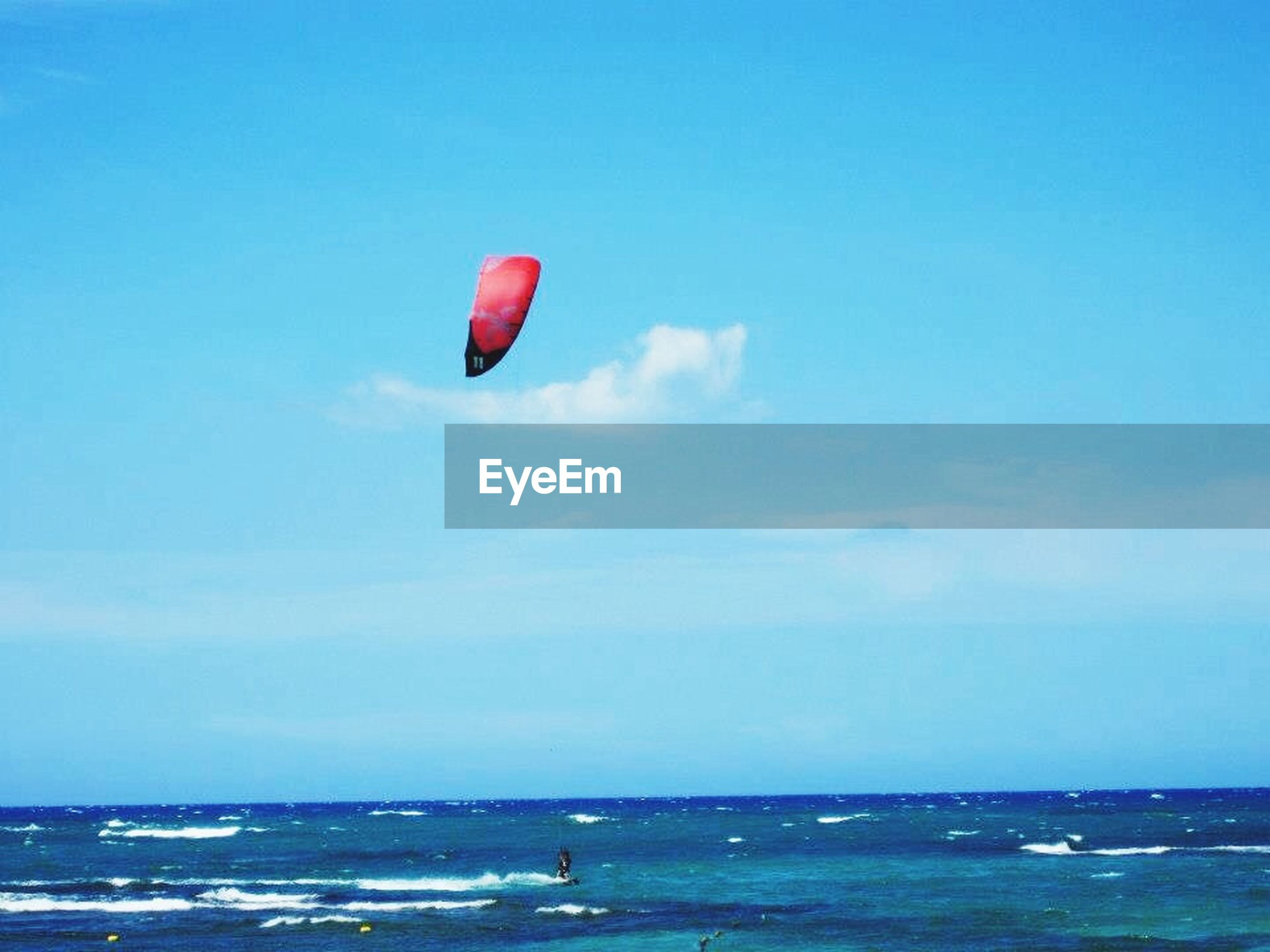 sea, water, horizon over water, blue, flying, sky, transportation, mid-air, scenics, waterfront, parachute, tranquility, beach, tranquil scene, beauty in nature, nature, paragliding, copy space, adventure, vacations