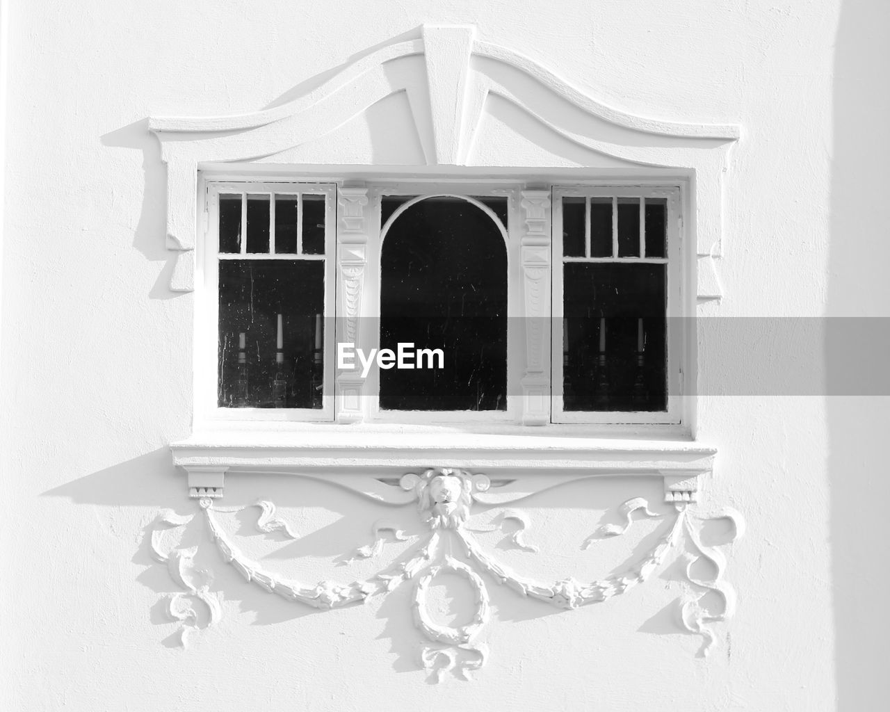 built structure, architecture, no people, building exterior, window, wall - building feature, white color, building, day, outdoors, close-up, low angle view, house, arch, pattern, shape, design, the past, art and craft, geometric shape, ornate, window frame