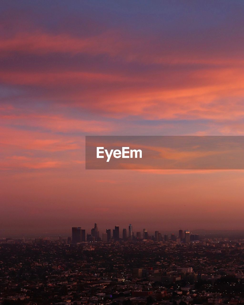 Aerial View Of Cityscape Against Romantic Sky During Sunset