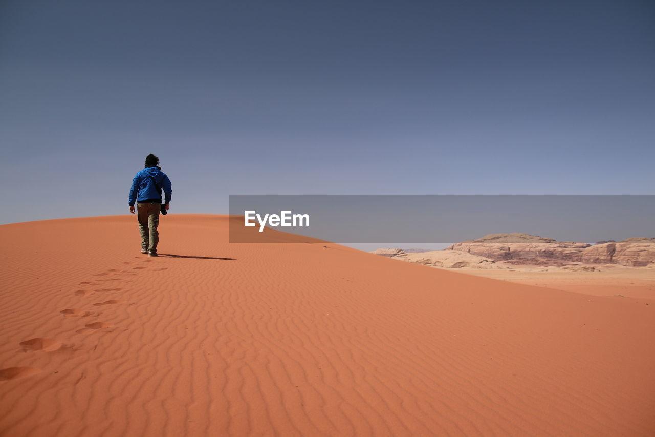 Rear view of man on desert