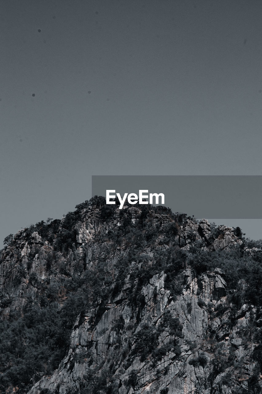 LOW ANGLE VIEW OF MOUNTAIN AGAINST CLEAR SKY