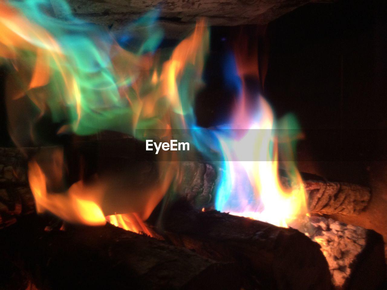 Close-up of burning wood at fireplace