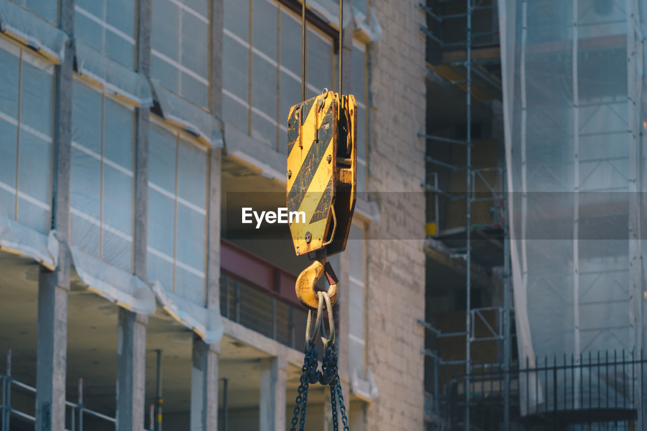 Crane Against Buildings At Construction Site