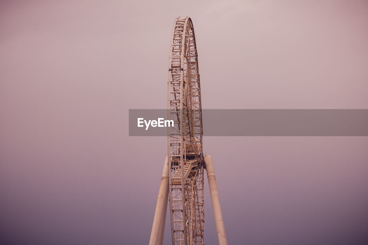tall - high, built structure, sky, architecture, amusement park ride, amusement park, copy space, no people, metal, tower, nature, outdoors, arts culture and entertainment, low angle view, day, clear sky, travel, development, construction industry, ferris wheel, skyscraper, construction equipment