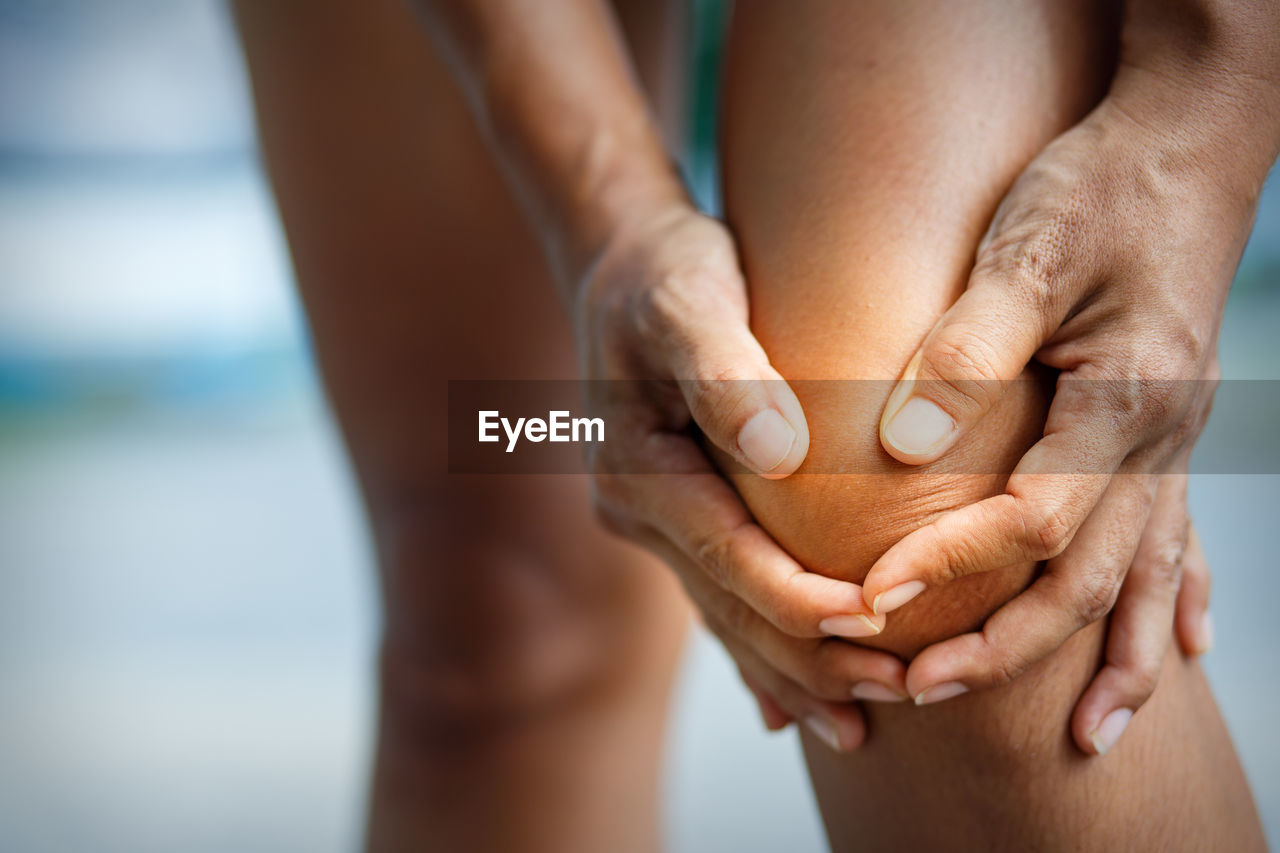 human body part, human hand, hand, body part, real people, two people, lifestyles, women, people, focus on foreground, day, adult, close-up, togetherness, human leg, bonding, limb, finger, leisure activity, human limb, couple - relationship