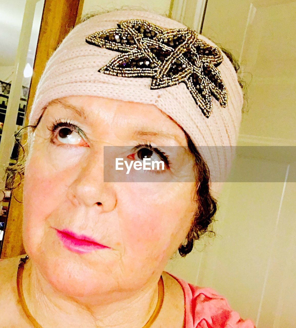 Close-up of thoughtful mature woman wearing bandana while looking away