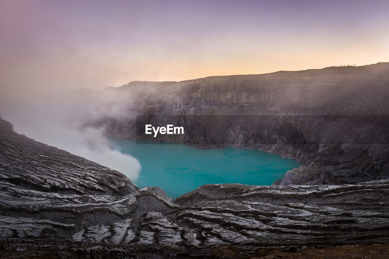 scenics - nature, beauty in nature, water, geology, physical geography, tranquil scene, non-urban scene, mountain, smoke - physical structure, tranquility, nature, heat - temperature, power in nature, environment, sky, landscape, no people, volcano, land, emitting, outdoors, hot spring, volcanic crater