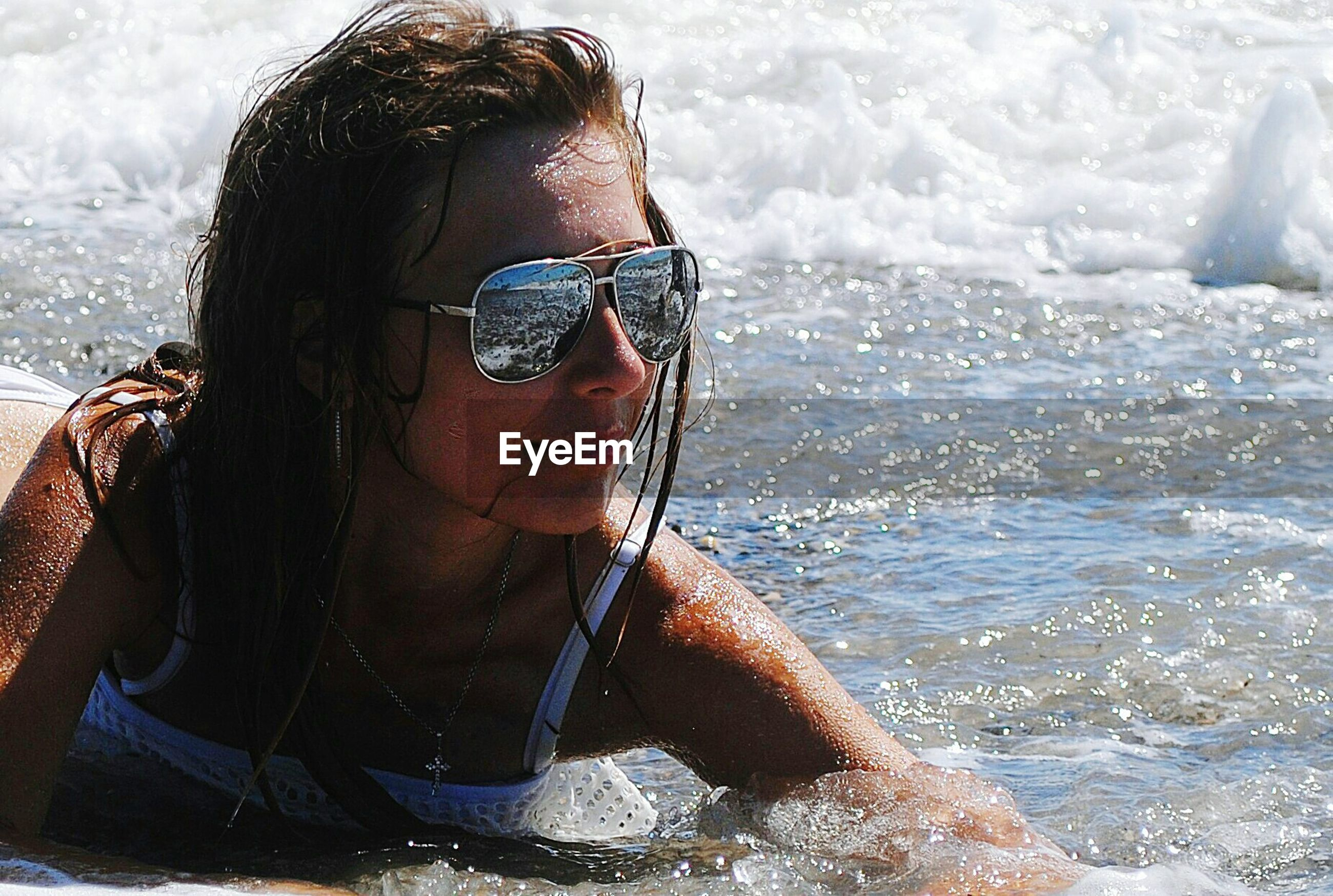 leisure activity, one person, young adult, real people, young women, lifestyles, sunglasses, water, sea, day, headshot, outdoors, front view, focus on foreground, adventure, nature, looking at camera, vacations, portrait, beautiful woman, beauty in nature, close-up, sky, adults only, adult, people