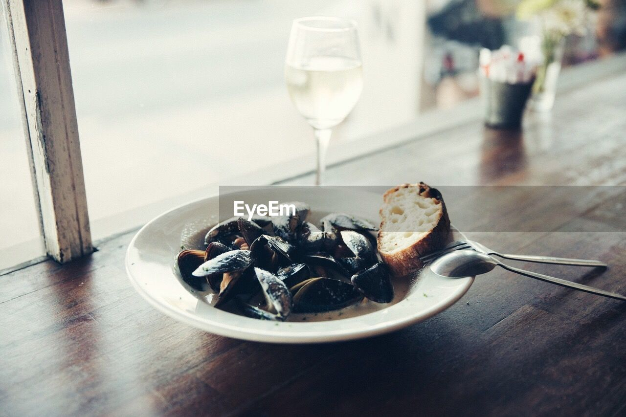 food and drink, table, drink, plate, indoors, food, serving size, close-up, focus on foreground, no people, freshness, refreshment, alcohol, wineglass, fork, drinking glass, ready-to-eat, wine, day, leftovers