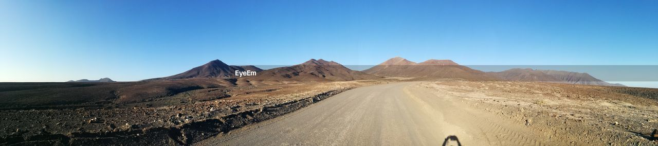 Panoramic View Of Mountain Road Against Clear Blue Sky