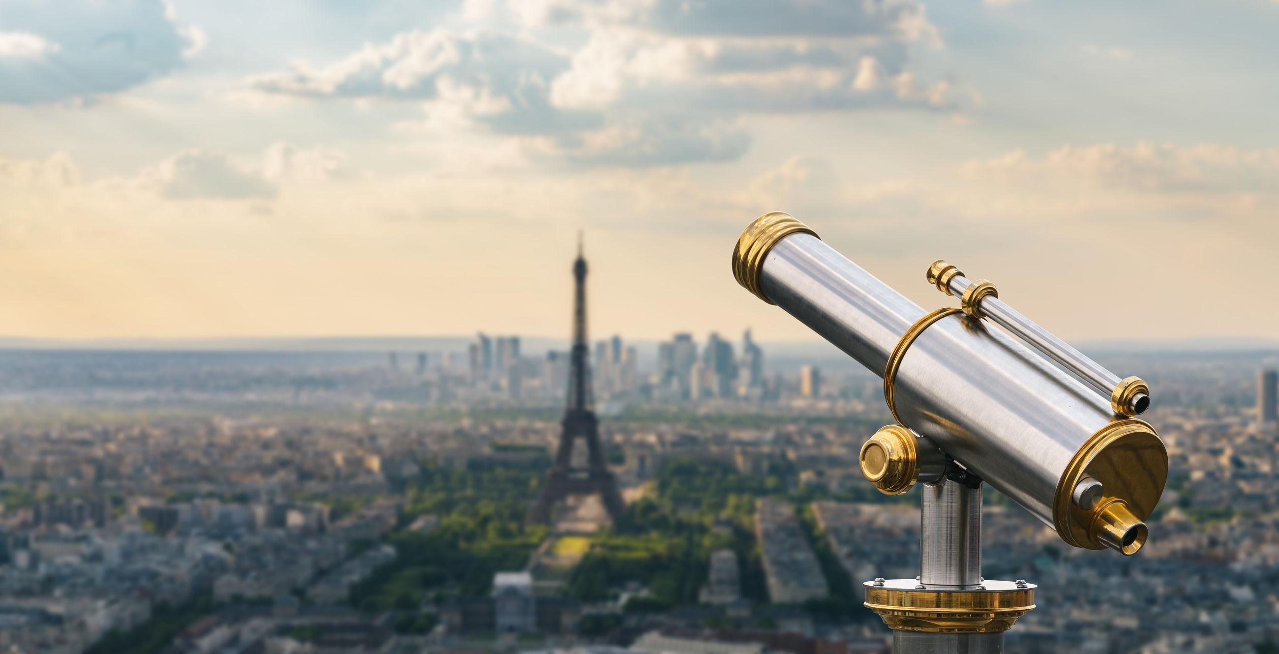 Coin-operated binoculars against eiffel tower