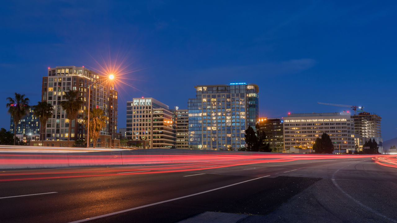 San jose downtown and car light trails on california state route 87 during the blue hour