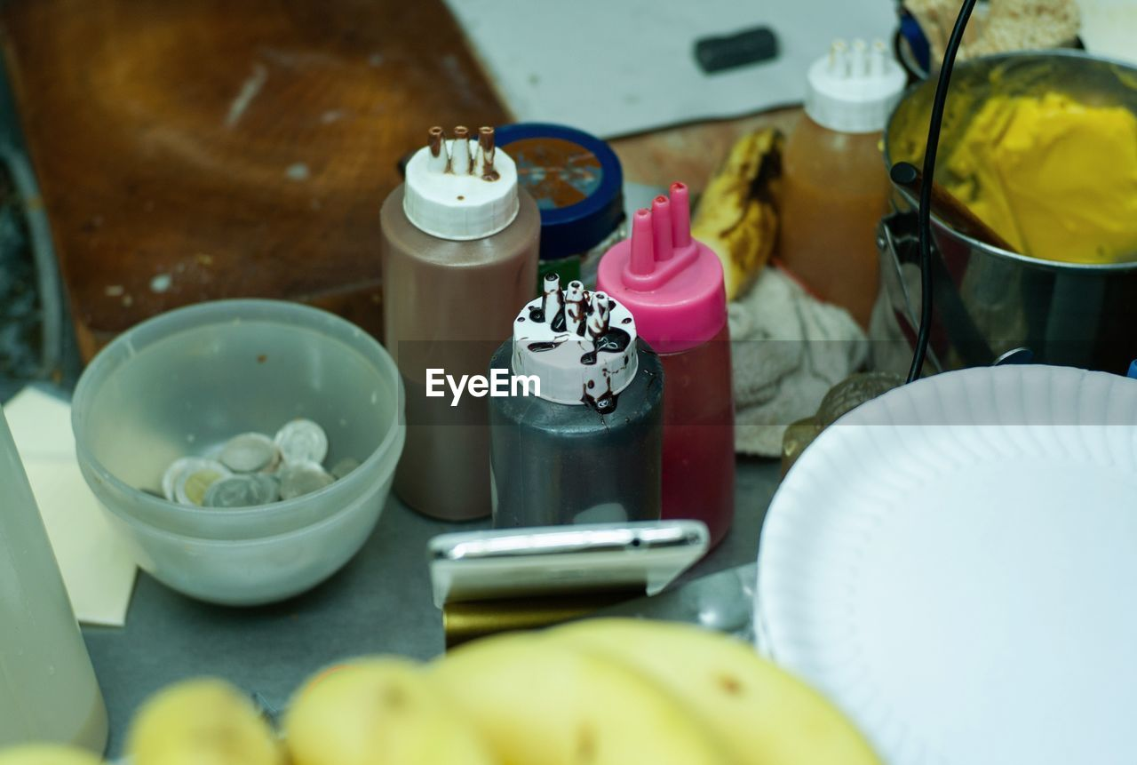 food and drink, container, food, table, still life, freshness, no people, indoors, fruit, healthy eating, high angle view, close-up, selective focus, bottle, focus on foreground, wellbeing, yellow, group, bowl, banana, crockery